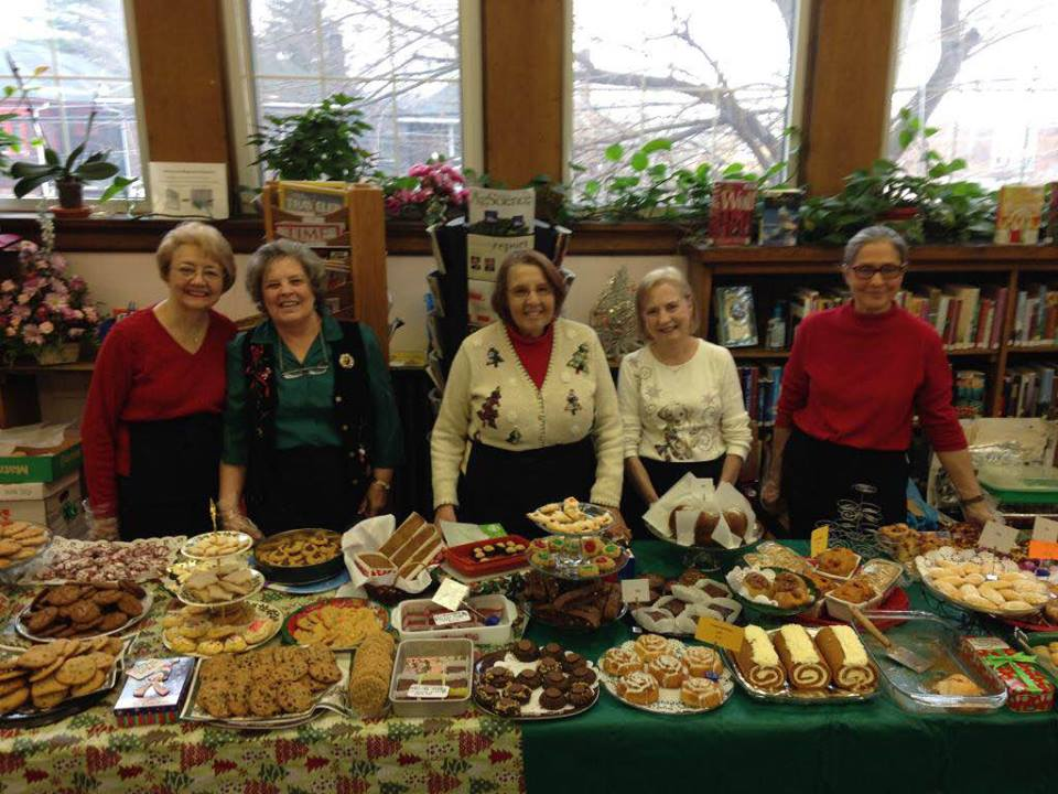 Friends of the Library with cookies at a bake sale